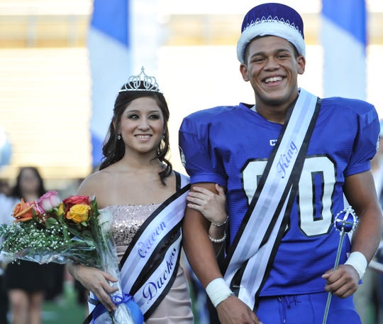 Lake View High School's Homecoming Queen Elizabeth Salazar and King Aaron Allen paused on the red carpet for photographs during the pre-game ceremony at the Chiefs' 2012 homecoming game.
