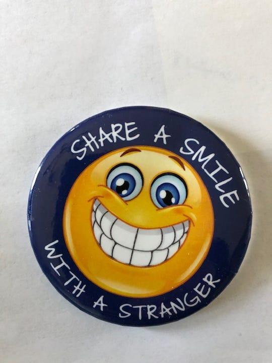 """Bob Erickson's """"Share a smile with a stranger"""" pins."""