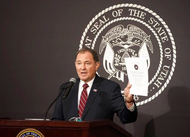 "Utah Gov. Gary Herbert holds up the ""Utah Leads Together Plan"" while speaking during a press conference with legislative, community, and business leaders at the Utah State Capitol Friday, April 17, 2020, in the Salt Lake City. Utah is aiming to reopen restaurants and gyms and resume elective surgeries in early May under a plan to gradually reopen the economy that has been decimated by the coronavirus pandemic, Gov. Herbert said Friday. (Jeffrey D. Allred/Deseret News, via AP, Pool)"