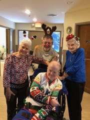 Peter Prater, in wheelchair with brother Jimmy Prater, mother, Anise and friend at Christmas party. Peter Prater was first resident of Tallahassee Developmental Center to test positive for the coronavirus.