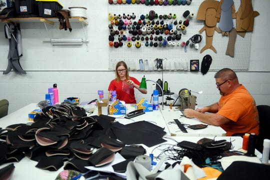 Tcn Sebastian Masks  Robert Doerr and daughter, Skyler, sit at their respective stations among protective face masks in various states of production on April 17 at Robert Doerr Upholstery shop in Sebastian. Doerr transformed his custom upholstery shop into a production line of face masks to be shipped out to customers and walk-in community members.