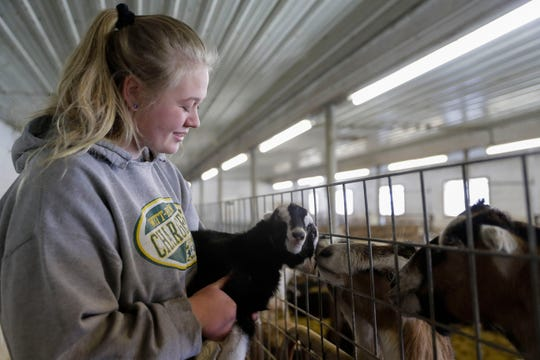 Jocelyn Nueske holds a baby goat, Janus, on Friday, April 17, 2020, at Nueske Farms in Wittenberg, Wis. Janus was born on April 5 with two faces and is named for the two-faced Roman god.