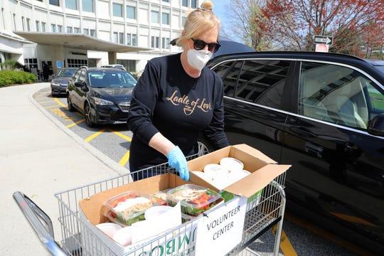 Leslie Lampert, owner of Ladle of Love, delivers meals to Northern Westchester Hospital in Mount Kisco April 17, 2020.