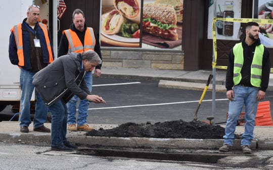 Carmel Town Board member Mike Barile takes a picture of his unauthorized connection, at the corner of Route 6N and Clark Place in Mahopac on March 10.