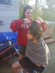 Chris Tobin, gets a hair cut from his girlfriend Jordan Walter during the pandemic.