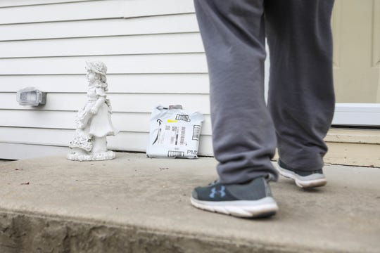 A Delaware Amazon delivery contractor, who asked not to be identified, delivers packages during the coronavirus pandemic.