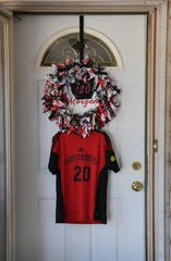 The front door of the Whipple home is dedicated to Old High senior Morgan Whipple who will miss her senior season as a soccer player for the Lady Coyotes.