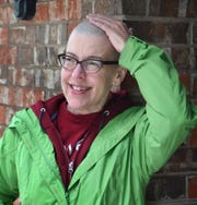 Mitzi Lewis, an associate professor at Midwestern State University, is still getting used to her smooth head. She decided to shave off all her hair during the quarantine for the COVID-19 pandemic..