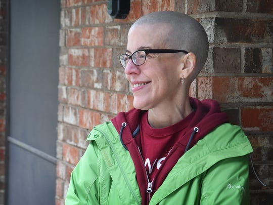 Dr. Mitzi Lewis, a professor at Midwestern State University, models her new hair do. Lewis chose to shave her hair off while quarantining for the coronavirus pandemic.