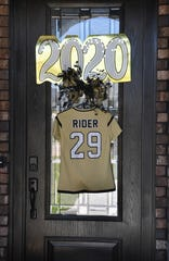 Mindy Shoffit's Lady Raiders soccer jersey hangs on the front door of her home.