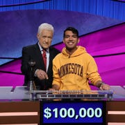 'Jeopardy!' host Alex Trebek, left, poses with 2020 College Championship winner Nibir Sarma, who will take the $100,000 grand prize back home to Minnesota.