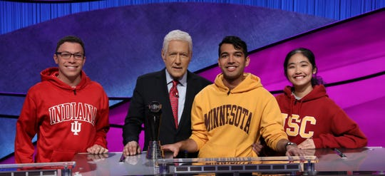 'Jeopardy!' host Alex Trebek, second from left, joins with 2020 College Championship finalists Tyler Combs, left, Nibir Sarma and Xiaoke Ying. Sarma took the crown Friday.