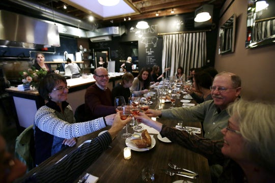This Sept. 27, 2013 photo shows patrons toasting at Naomi Pomeroy's Beast restaurant in Portland, Ore.