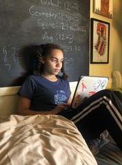 Ella Canady, 15, completes her school work online while at home in Phoenix, Arizona in April 2020. Like many teens, she's dealing with the stress of missing friends and rituals after schools shut down to contain the spread of the coronavirus.