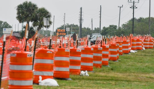 Construction cones line both sides of the roadway at Parrish Park in Titusville on a rainy Saturday morning. Mandatory Credit: Craig Bailey/FLORIDA TODAY via USA TODAY NETWORK