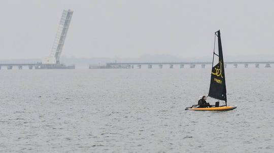 A sailboat off Parrish Park in Titusville heads for shore as the rain begins to fall Saturday morning. Mandatory Credit: Craig Bailey/FLORIDA TODAY via USA TODAY NETWORK