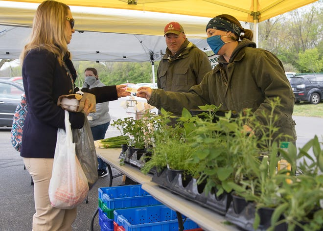 Chillicothe's local winter farmers market has local farmers and other retailers continue to sell their products while implementing social distancing and cleanliness amid the coronavirus epidemic on April 18, 2020.