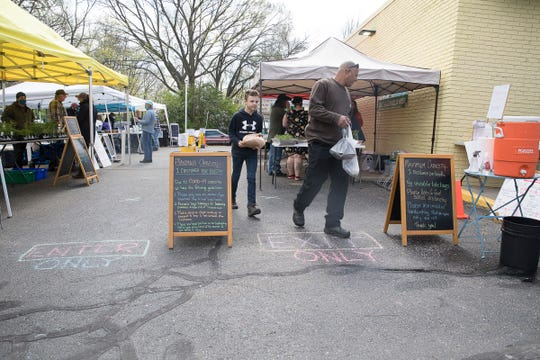 Patrons are asked to enter and exit certain ways and practice social distancing while visiting the Chillicothe winter's market on April 18, 2020.