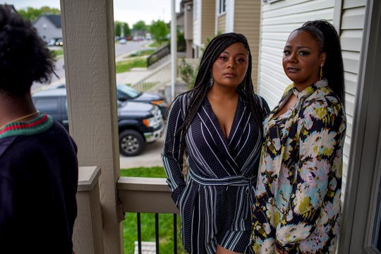 Tatiana Secherest, right, and her sister BreAnna Anderson pose for a portrait in front of the Secherest home in Clarksville, Tenn., on Friday, April 17, 2020.