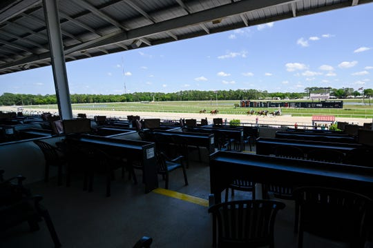 Jockey Wesley Henry atop R D Have Faith (2) wins the third race of the day as the Tampa Bay Downs is closed to the public at Tampa Bay Downs on March 18, 2020.