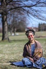 Heather Robinson, a certified professional midwife, has her photo taken in a neighborhood parks just blocks away from a client in Troy on April 2, 2020.