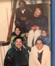 The Gambrell-Fowler family pose for a picture on a staircase. Clockwise from the top are: Keith Gambrell, Paris Fowler, Ross Fowler, Cheryl Fowler, Gary Fowler, and Troy Fowler.