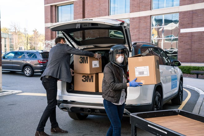 Constellation Agency Chief Product Officer Matt Woodruff and CEO Diana Lee, who launched the Do-Good Auto Coalition, unload cases of 3M respirators on Tuesday for frontline staff at Englewood Health in New Jersey.