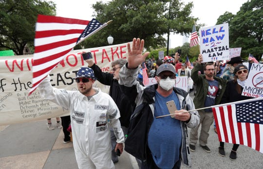 Protesters rally at the Texas State Capitol on Saturday to speak out against Texas' handling of the COVID-19 outbreak in Austin, Texas. Austin and many other Texas cities remain under stay-at-home orders due to the COVID-19 outbreak except for essential personal.