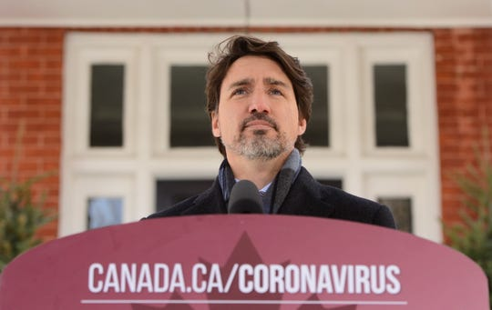 Prime Minister Justin Trudeau addresses Canadians on the COVID-19 pandemic from Rideau Cottage in Ottawa on Thursday, April 16, 2020. (Sean Kilpatrick/The Canadian Press via AP)