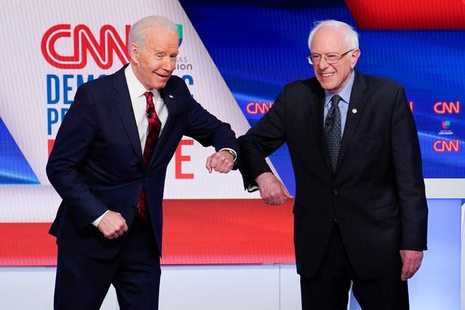 Former Vice President Joe Biden, left, will let Sen. Bernie Sanders, I-Vt., right, keep his delegates at the convention though Sanders has dropped out of the Democratic presidential primary race.