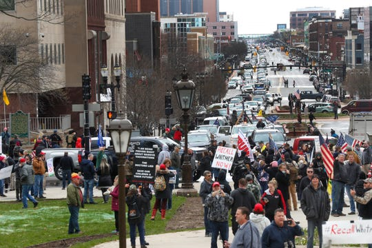 Protesters gather at the Michigan State Capitol in Lansing, Mich., Wednesday, April 15, 2020.