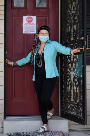 "Robin Lawrence poses for a portrait outside of her home, which friends lovingly refer to as the ""Robin's Nest"" in Newburgh, Ind., Friday, April 3, 2020. Lawrence, a former body-builder, has stage 4 cancer and has to severely limit who she comes into contact with due to the COVID-19 pandemic."