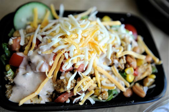 A chicken taco salad with lettuce, chicken breast, beans, veggies and cheese ready to be distributed by Urban Seeds on Thursday, Apr. 15, 2020.
