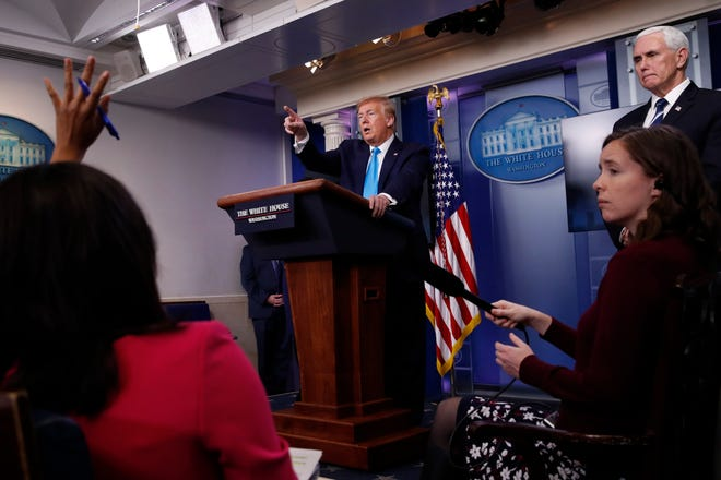 In this April 7, 2020, photo, President Donald Trump calls on a reporter for a question as he speaks about the coronavirus in the James Brady Press Briefing Room of the White House in Washington.