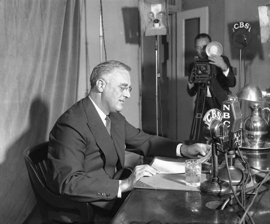 President Franklin D. Roosevelt makes a radio speech on September 30, 1934, as one of a series of fireside chats in Washington. It was his sixth fireside chat and focused on government and capitalism. (AP Photo)