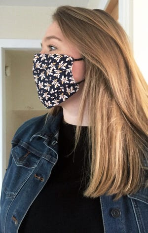 Grace Gibney models one of the masks that she made for the Great Falls College Community Choir.