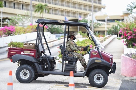 A Guam National Guard soldier operates a utility vehicle at the Pacific Star Resort & Spa entrance in Tumon, April 18, 2020.
