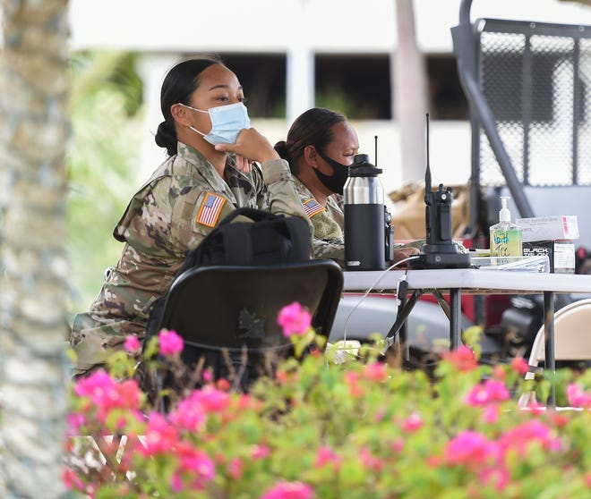 Guam National Guard soldiers are stationed at the Pacific Star Resort & Spa entrance in Tumon, April 18, 2020.