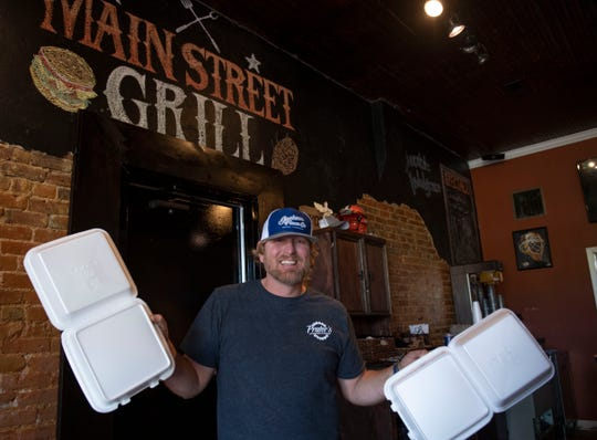 Josh Youmans, owner of Main Street Grill, is offering takeout food service in Medina, Tenn., on Wednesday April 15, 2020.
