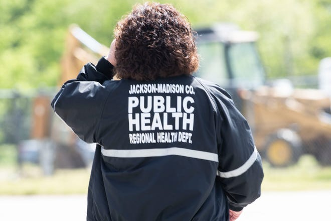 Kim Tedford, executive director of the Jackson-Madison County Regional Health Department, visits the testing site at the Jackson Fairgrounds on Saturday, April 18, 2020.