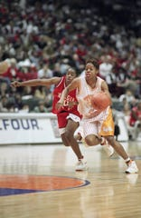 Tennessee forward Nikki McCray, right, races down court pursued by Georgias Saudia Roundtree during the second half of NCAA Womens Final Four semifinal game, Saturday, April 1, 1995, Minneapolis, Minn. McCray led the Lady Vols with 22 points as they advanced to Sundays final with a 73-51 win over Georgia. (AP Photo/Bob Child)