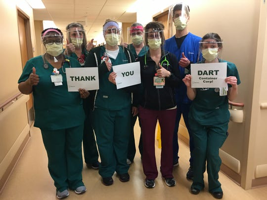 Employees at Sparrow Hospital pose with face shields donated by Dart Container to help protect against COVID-19 transmission.