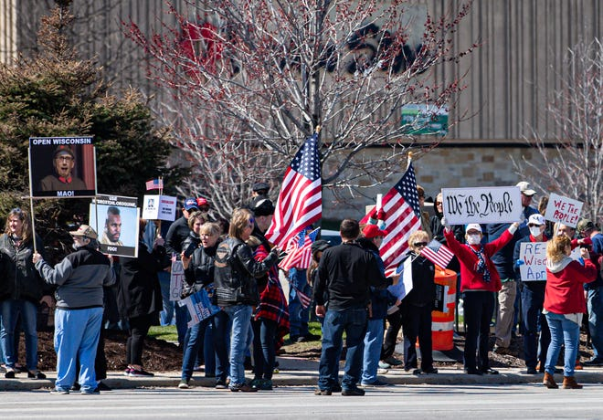 Demonstrators line West Bluemound Rd. in front of Brookfield Square shopping mall on Saturday despite social distancing guidelines. The gathering was a protest of Gov. Tony Evers' decision to extend the stay-at-home order through May 26.