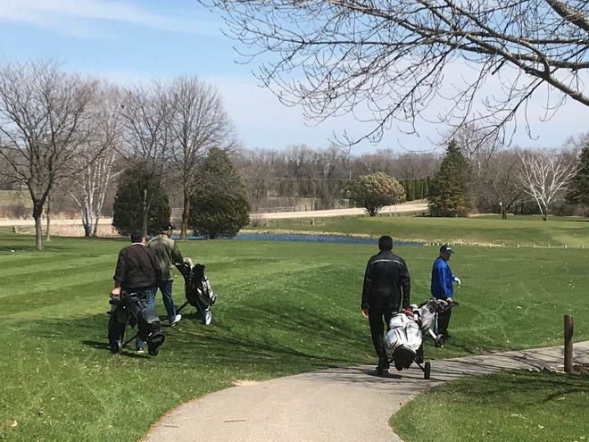 Players pack the tee sheet at Kettle Hills Golf Course in Richfield last year when Washington County opened it courses.