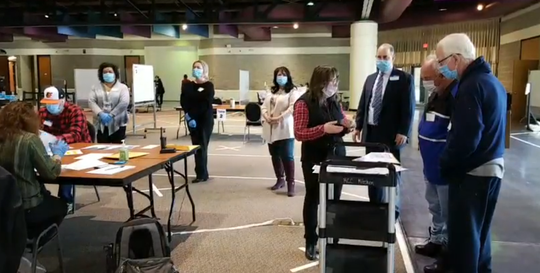 Poll workers begin the recount of the Racine school district's $1 billion referendum, which passed by a five-vote margin.