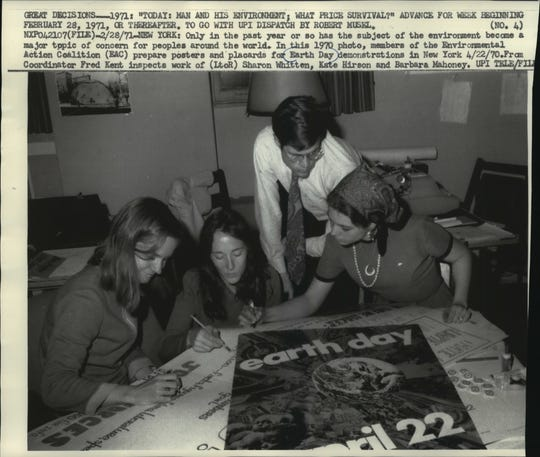 Members of the Environmental Action Coalition  prepare posters and placards for Earth Day demonstrations in New York in 1970.