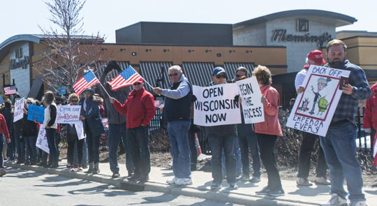 Demonstrators line West Blue Mound Road in front of Brookfield Square shopping mall on Saturday despite social distancing guidelines. The gathering was a protest of Gov. Tony Evers' decision to extend the stay-at-home order through May 26.