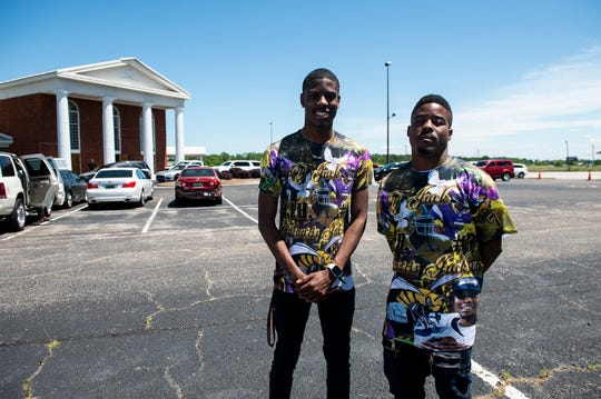 Darrin Hooper and Brandon Richmond wear shirts commemorating their cousin during the funeral for NFL quarterback and Montgomery native Tarvaris Jackson at True Divine Baptist Church in Montgomery, Ala., on Saturday, April 18, 2020.