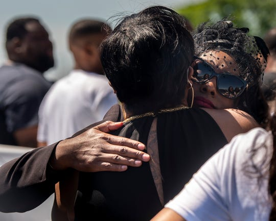 Lakitta Jackson, right, hugs family following the funeral for NFL quarterback and Montgomery native Tarvaris Jackson at True Divine Baptist Church in Montgomery, Ala., on Saturday, April 18, 2020.