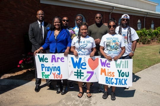 Former Lanier classmates pose for a picture during the funeral for NFL quarterback and Montgomery native Tarvaris Jackson at True Divine Baptist Church in Montgomery, Ala., on Saturday, April 18, 2020.